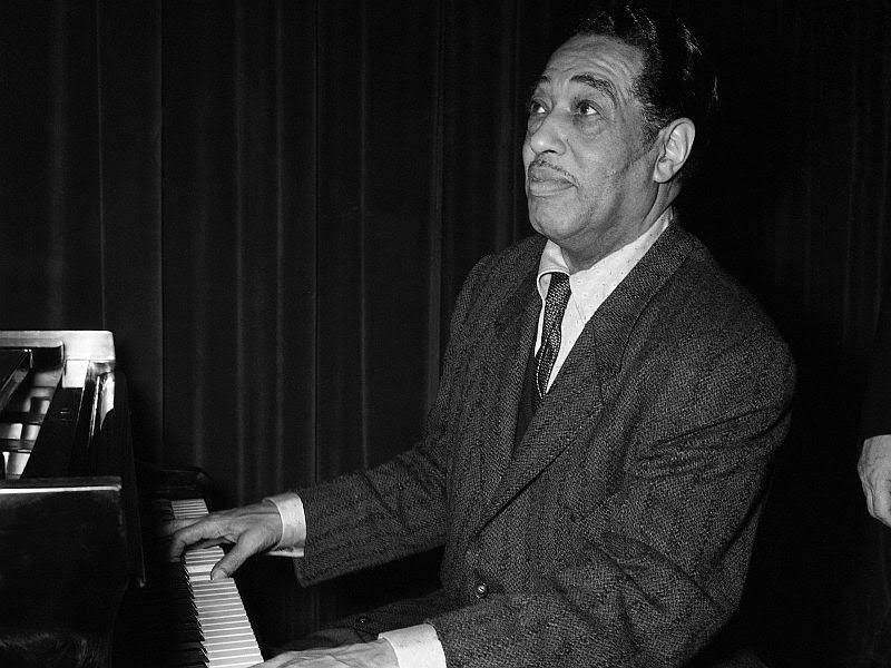 World known American jazzman Duke Ellington, guest of the American Cultural center of Paris at a cocktail party given in his honor, Oct. 27, 1958. Duke Ellington and his orchestra have been giving several jazz recitals in the French capital. (AP Photo)