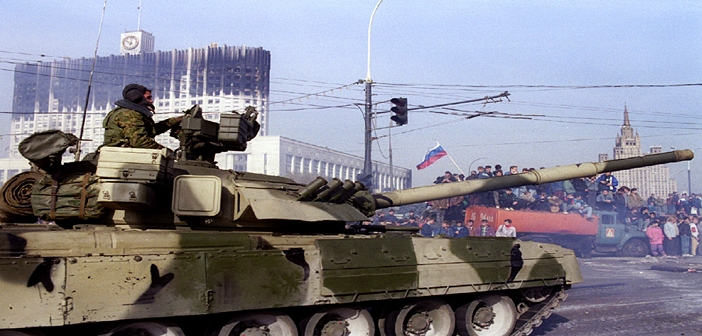 Russian tank leaves its post in front of the Moscow's White House building October 5. Yeltsinist for..