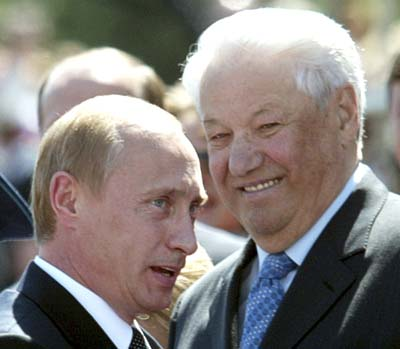 File photo of Russia's President Putin speaking as former Russian president Yeltsin smiles in Moscow