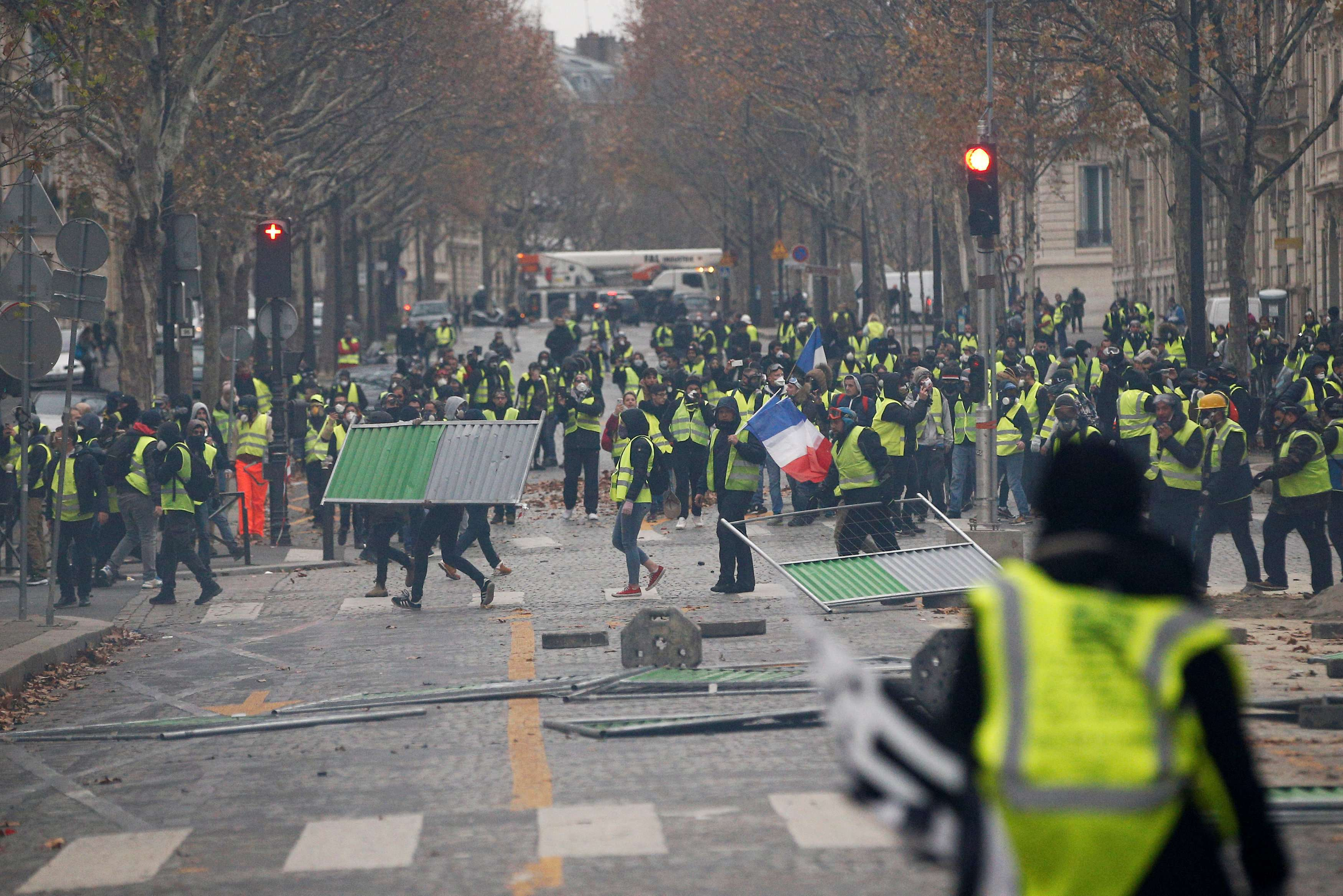 Protesters wearing yellow vests, a symbol of a French drivers' protest against higher diesel taxes, demonstrate in Paris, France, December 1, 2018. REUTERS/Stephane Mahe