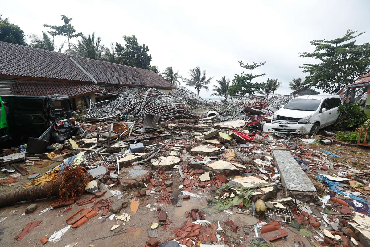 epa07246247 A view of damage with a car sitting among debris after a tsunami hit the Sunda Strait in Pandeglang, Banten, Indonesia, 23 December 2018. According to the Indonesian National Board for Disaster Management (BNPB), at least 43 people dead and 584 others have been injured after a tsunami hit the coastal regions of the Sunda Strait. EPA-EFE/ADI WEDA