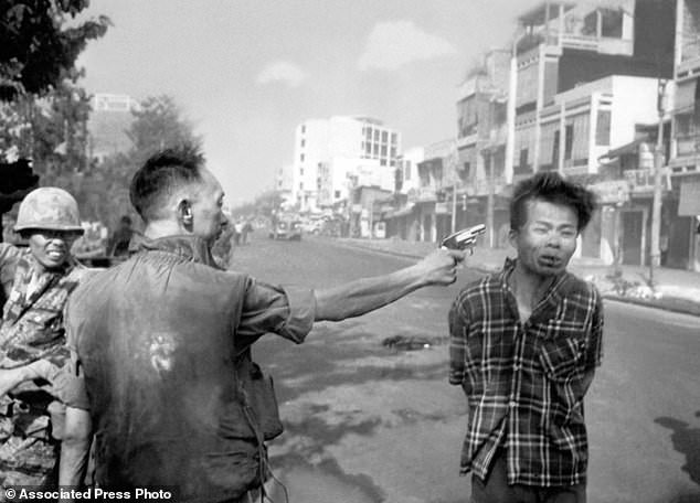 FILE - In this Feb. 1, 1968, file photo, South Vietnamese Gen. Nguyen Ngoc Loan, chief of the National Police, fires his pistol into the head of suspected Viet Cong officer Nguyen Van Lem (also known as Bay Lop) on a Saigon street, early in the Tet Offensive. Early on the morning of Jan. 31, 1968, as Vietnamese celebrated the Lunar New Year, or Tet as it is known locally, Communist forces launched a wave of coordinated surprise attacks across South Vietnam. The campaign, one of the largest of the Vietnam War, led to intense fighting and heavy casualties in cities and towns across the South. (AP Photo/Eddie Adams, File)