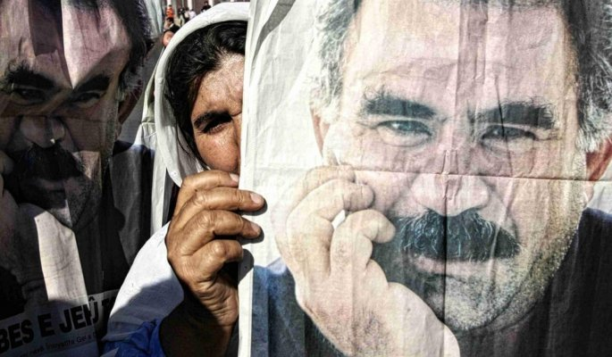 A Kurdish woman holds a poster of Abdullah Ocalan at a protest in Silopi near the Turkish Iraq border I November 2007 AFP