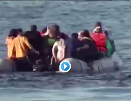 Greek coast guards were filmed firing shots into the sea near a dinghy full of people